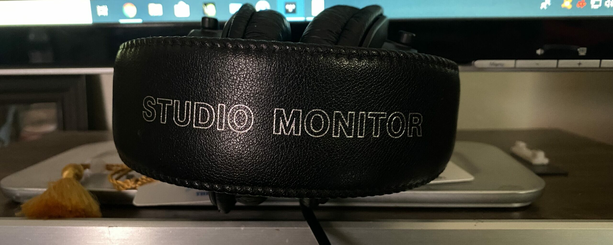 """The headband that is labeled 'Studio Monitor""""."""